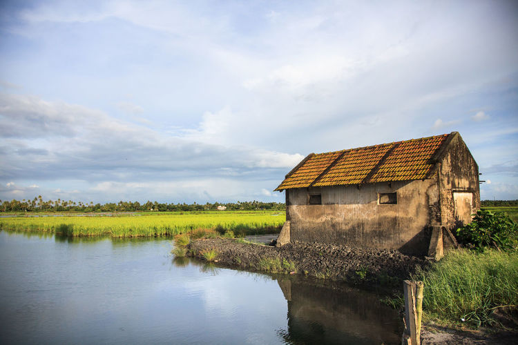 Agriculture Architecture Boathouse Built Structure Cloud - Sky Day Extreme Weather Lake Nature No People Outdoors Reflection Rural Scene Sky Water Watermill