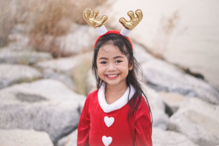 Little Santy/Reindeer on Stone dam at sea side.Little Girl in Santa Claus dress with Reindeer Headband. Santy  Santa Santa Claus Reindeer Stone Dam Sea Sea Side Thailand Winter Fashion Girl Little Girl Kid Asian  One Person Child Childhood Portrait Emotion Girls Looking At Camera Smiling Red Happiness Front View Standing Innocence Focus On Foreground Cute Females Women Day Outdoors Hairstyle