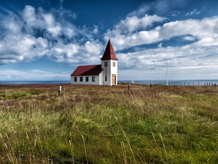 The church in Hellnar, Iceland, while less ubiquitous than the one in Budir, wins for being more scenic. Iceland Landscapes Landscape_Collection Church Travel Travel Photography Adventure Photography Cloud - Sky Outdoors Rural Scene No People Iceland_collection Scenics Grass Sky