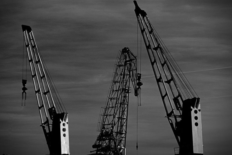 Sky Cloud - Sky Machinery Construction Industry Industry Crane - Construction Machinery Development Metal Low Angle View No People Construction Site Nature Day Incomplete Outdoors Architecture Built Structure Tall - High Transportation Building - Activity Construction Equipment Sailboat