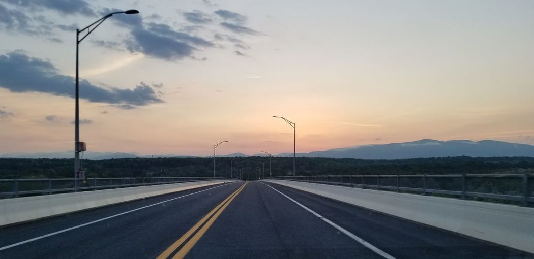 View of highway against sky during sunset