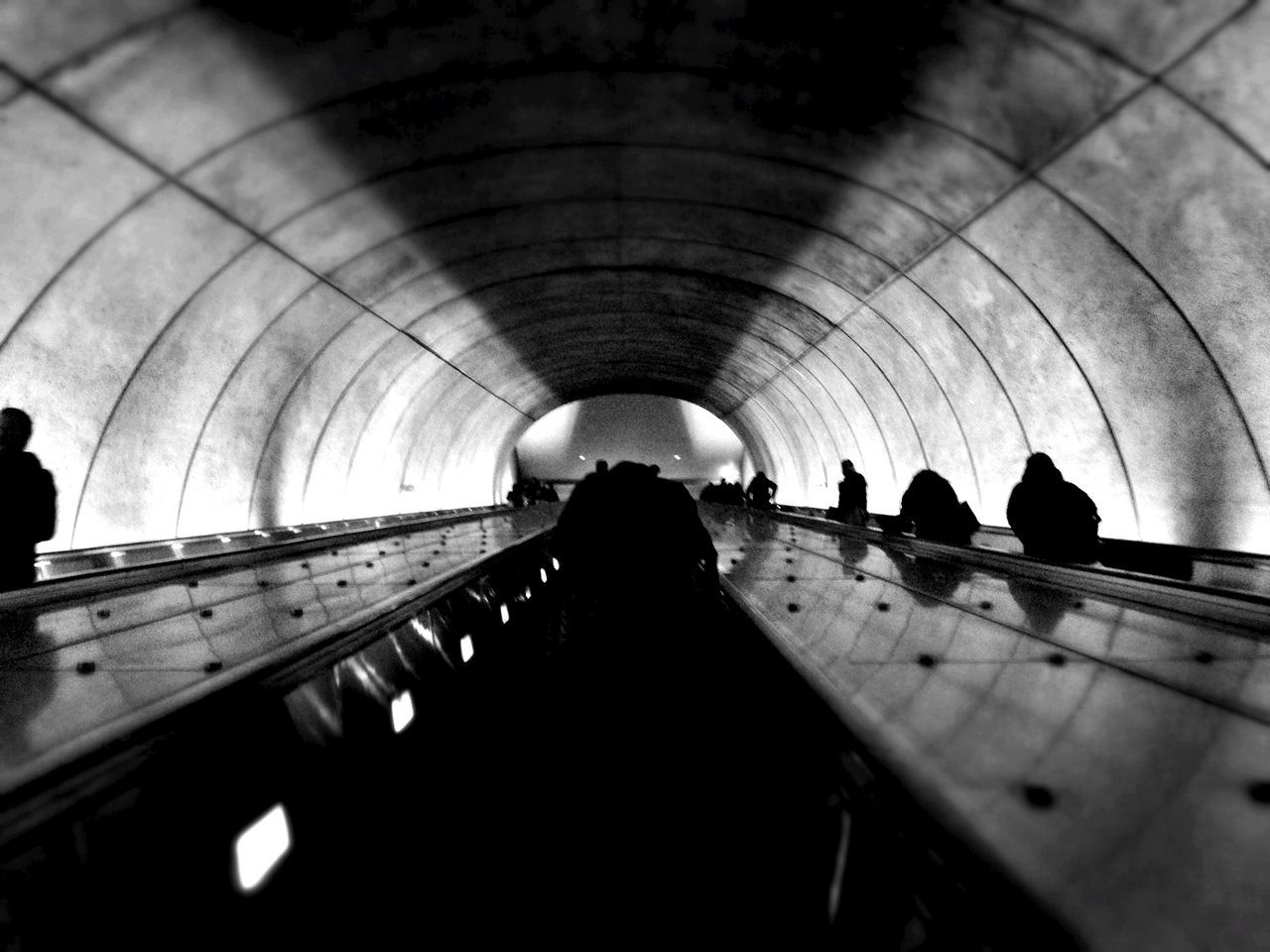 Silhouette people on escalator
