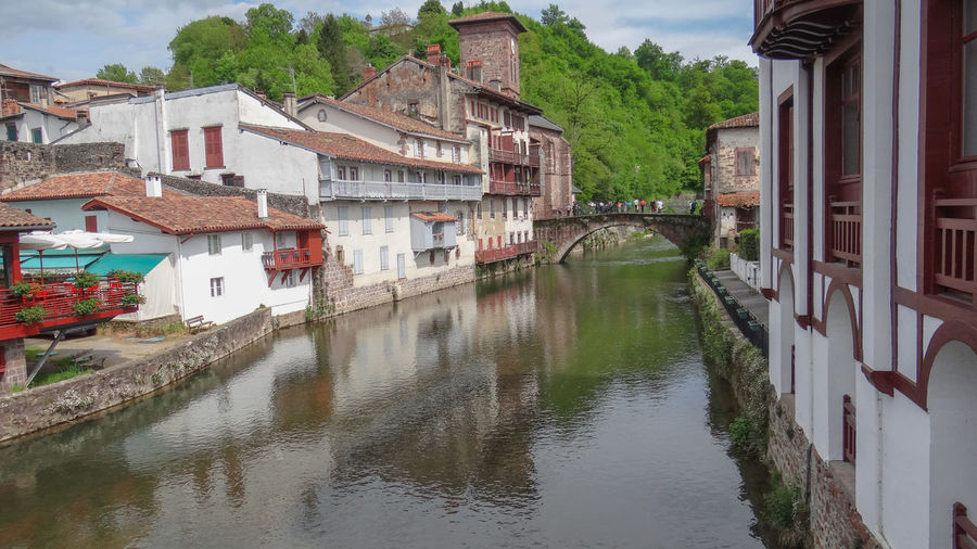 River amidst buildings in town