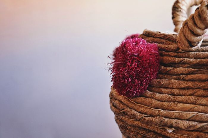 Wicker Wicker Basket Pink Pompon Tassel Hamper Basket No People Indoors  Close-up Copy Space Wall - Building Feature Brown Still Life Stack Red Focus On Foreground Hanging