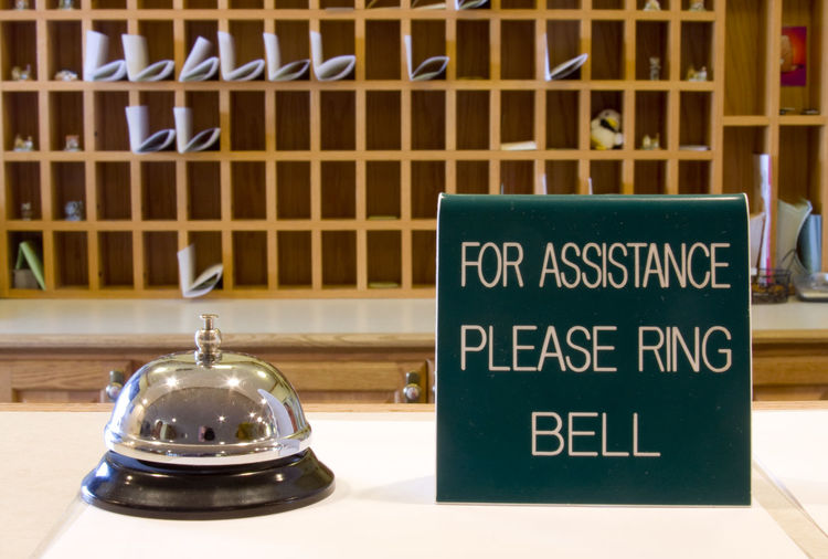 Hotel desk with bell for assistance, Hotel, Service, Hard Work, Friendly Assistance, Bell. Close-up Day Desk, Indoors  No People Reception, Register, Text
