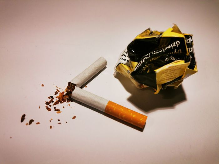 High angle view of cigarette smoking on table