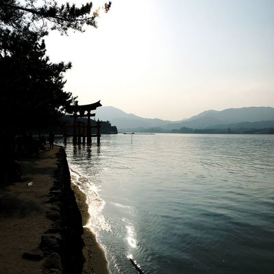 Miyajima Torii Gate Beach Beauty In Nature Day Idyllic Mountain Mountain Range Nature No People Non-urban Scene Outdoors Pier Scenics - Nature Sea Silhouette Sky Tranquil Scene Tranquility Water