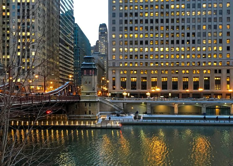 City lights illuminate and reflect off of the Chicago River during evening rush hour in winter. Chicago Chicago River Chicago Riverwalk Chicago Loop Downtown Chicago LaSalle Street Bridge Reflection Architecture Bridge - Man Made Structure Bridgehouse Building Exterior Built Structure City City Night Lights Cityscape Illuminated Illumination Modern No People Outdoors Reflection Snow Travel Destinations Water Waterfront