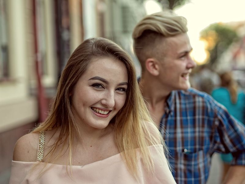 A young man gets acquainted with a girl on the street Gerl Man Young Acquainted Blond Hair Caucasian Close-up Day Focus On Foreground Friendship Getting Inspired Happiness Incidental People Leisure Activity Lifestyles Outdoors People Real People Smiling Street Togetherness Two People Young Adult Young Women