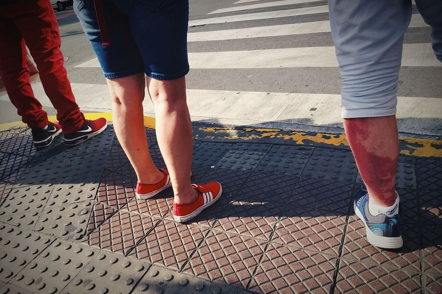 Crimson. Streetphotography Vscox Limb Human Body Part Day Outdoors Street Walking Shadow Road Standing People Mobility In Mega Cities