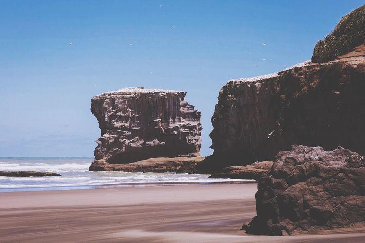 Sea Rock Formation Rock - Object Nature Water Rock Beauty In Nature Cliff Scenics Tranquility Clear Sky No People Sky Outdoors Beach Horizon Over Water Day