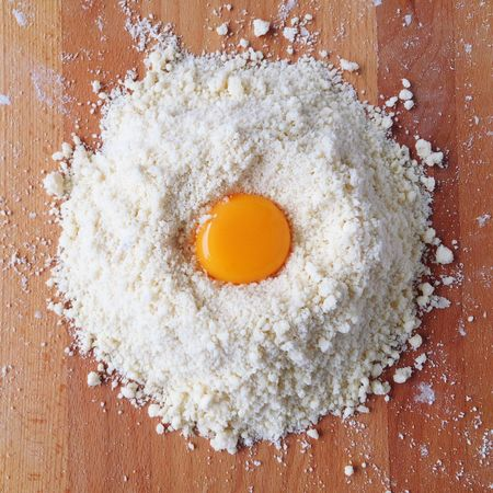 Egg Yolk Flour Baking Directly Above Vibrant Color Preparation  Ingredient Freshness Circle Close-up Dough Wooden Mixing Bake Table Dust Preparations Knead