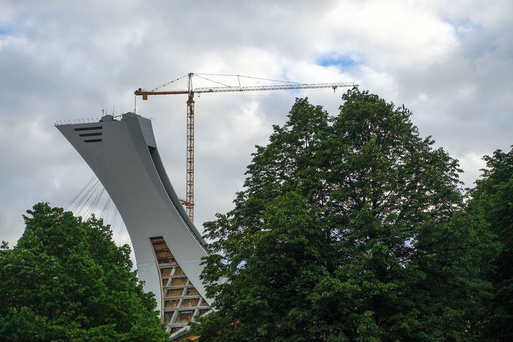 Architecture Built Structure Cloud - Sky Construction Site Day Growth Industry Low Angle View Nature No People Olympic Park  Olympic Stadium Outdoors Parc Olympique Sky Stade Olympique Tree
