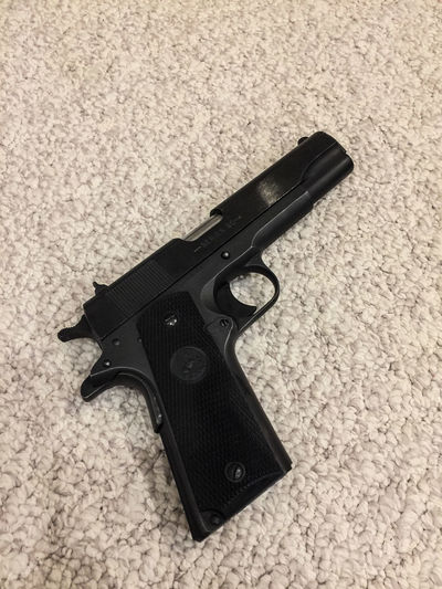 Aggression  Black Color Communication Crime Gun Handgun High Angle View Indoors  No People Protection Rug Safety Security Sign Single Object Social Issues Technology Violence Warning Sign Weapon