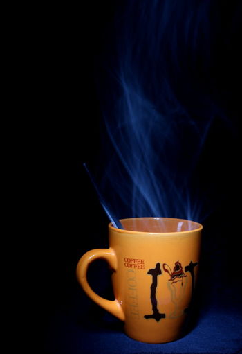 Close-Up Of Smoking Emitting From Coffee Cup