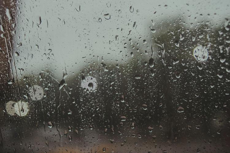 Wet Drop Window Glass - Material Rain Water Transparent Indoors  Full Frame Backgrounds No People Nature Rainy Season Close-up RainDrop Transportation Day Glass