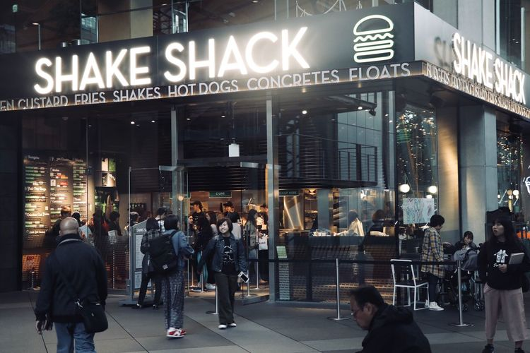 Shakeshackjapan Large Group Of People Text Communication Building Exterior Built Structure City Architecture Men Illuminated Night Women Crowd Real People Outdoors Cafe Neon Adult People