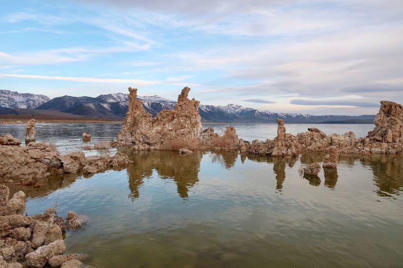 Landscape of Tufa formations in Mono Lake Mono Lake Tufa EyeEm Selects Water Sky Reflection Cloud - Sky Nature Day No People Tranquility Waterfront Scenics - Nature Outdoors Solid Tranquil Scene Lake Beauty In Nature