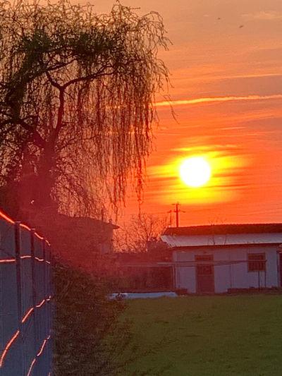 Scenic view of building against orange sky