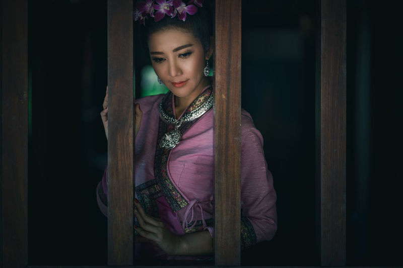 Beautiful Thai woman with traditional Lanna cloth. One Person Young Adult Front View Real People Traditional Clothing Women Young Women Lifestyles Beautiful Woman Clothing Leisure Activity Indoors  Portrait Waist Up Beauty Adult Looking Three Quarter Length Purple Scarf Thailand Lanna Culture Traditional Thai Travel Dress Old-fashioned Antique