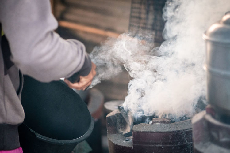 Cropped image of woman preparing food
