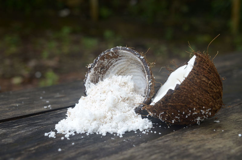 Grated coconut in wooden table
