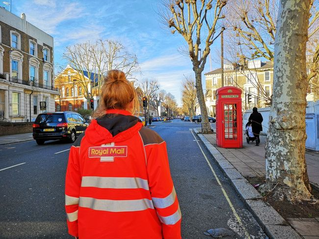 Royal mail postwoman Girl Power Parcel Service Parcel Business Finance And Industry Woman At Work Xmas Red Telephone Box Telephone Booth Huawei P20 Pro Huwaei Photography Delivery Delivery Service Delivering Royal Mail Courrier Uniform City Red Women
