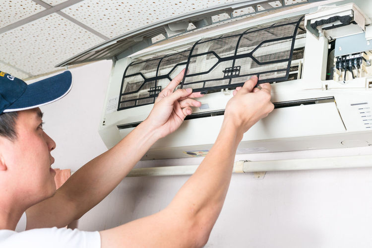 Man repairing air conditioner