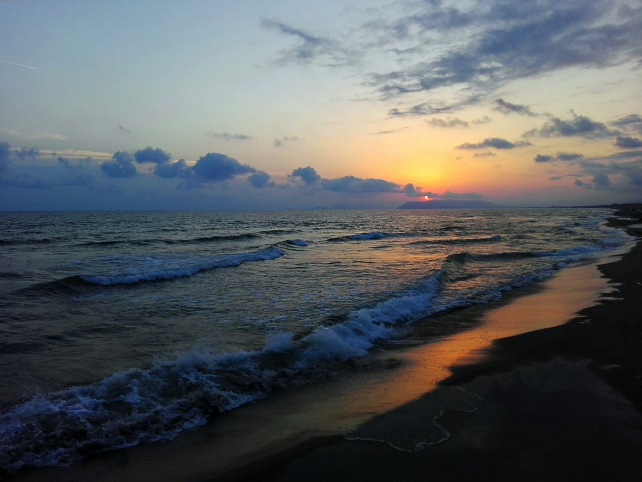 sea, sunset, beauty in nature, wave, beach, water, sky, nature, scenics, surf, tranquil scene, horizon over water, shore, tranquility, cloud - sky, sand, no people, outdoors, idyllic, tide, power in nature, travel destinations, vacations, day