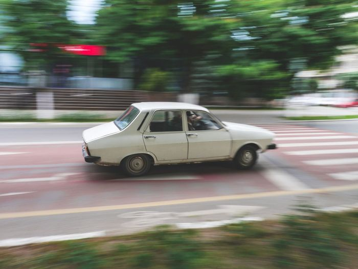 Car moving on road in city