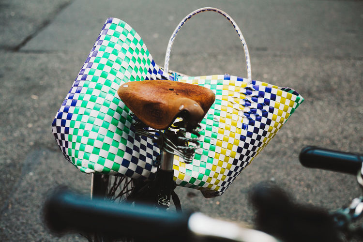 Close-Up Of Multi Colored Bag On Bicycle On Street