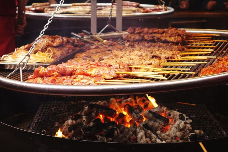 Close-Up Of Meat With Skewers On Barbecue Grill