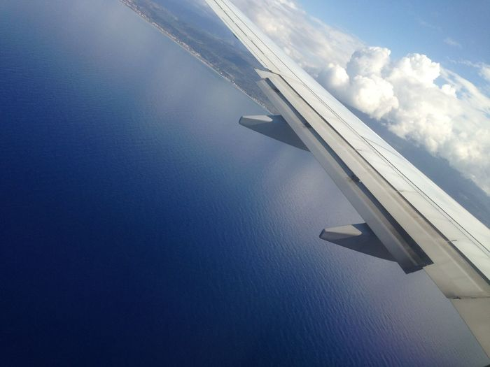 Il mare della Calabria visto dall'alto. Air Vehicle Airplane Airplane Wing Beauty In Nature Calabria (Italy) Day Mode Of Transport Nature Nautical Vessel No People Outdoors Scenics Sea Sea And Sky Sky Tranquil Scene Tranquility Transportation Wake - Water Water