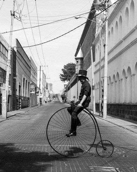 Man riding bicycle on street in city