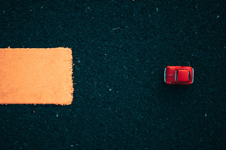 High angle view of red toy car
