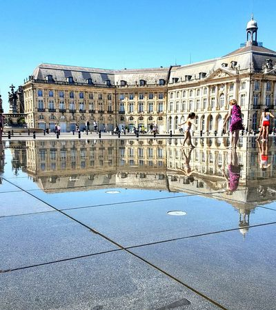 Bordeaux Building Exterior Architecture Clear Sky City Water City Life Person Outdoors Famous Place Façade Architecture Horizon Over Water Symetry Symetricphoto Blue
