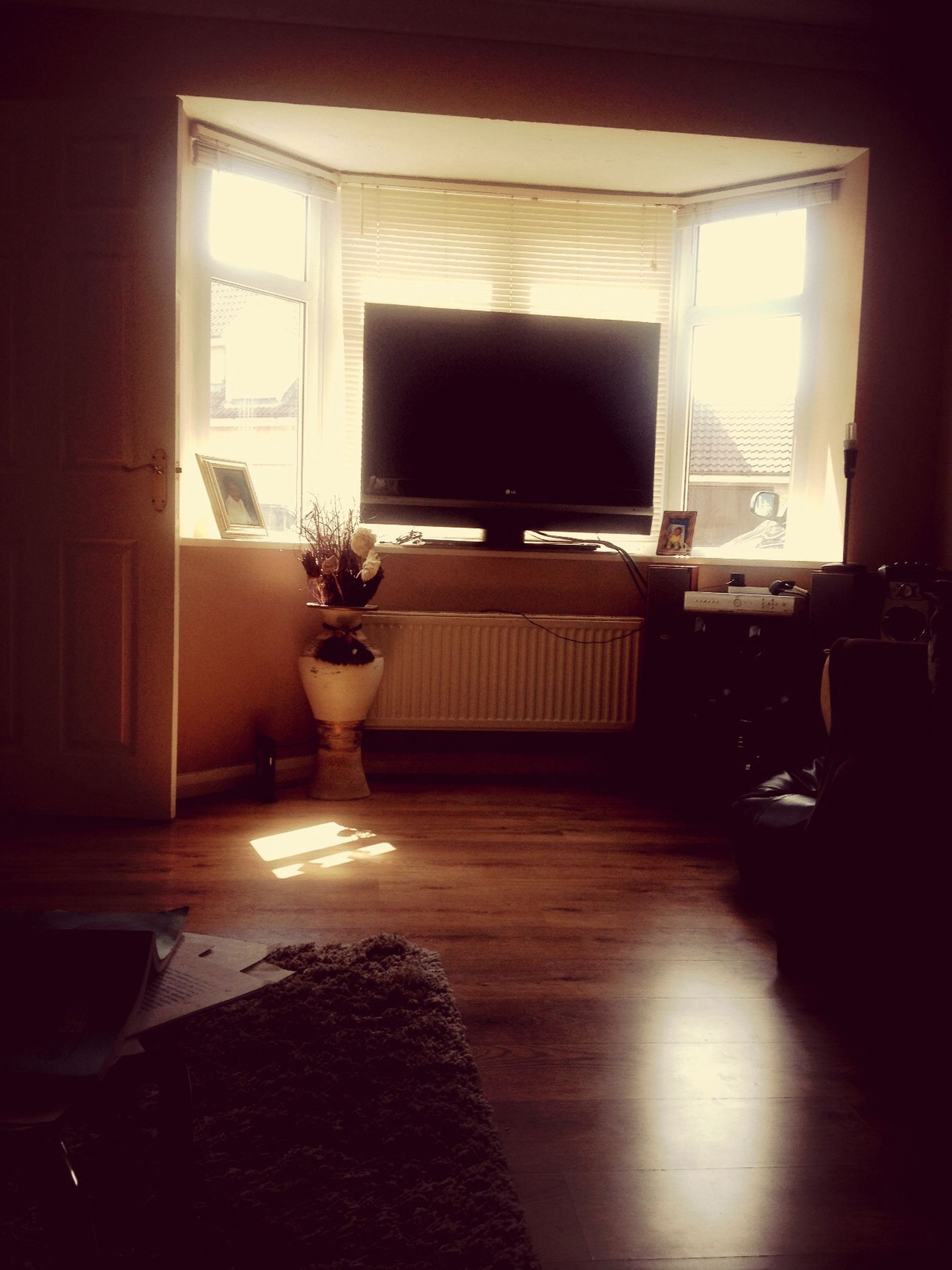indoors, window, table, home interior, architecture, house, chair, built structure, glass - material, absence, door, reflection, domestic room, transparent, room, no people, dark, empty, open, living room
