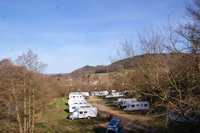 Camping Caravan Park Caravanning Bare Tree Beauty In Nature Building Exterior Built Structure Caravans Day High Angle View Holiday Park Mobile Home Mobile Home Park Mountain Nature No People Outdoors Sky Tree