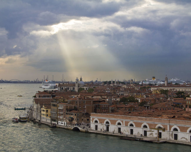 Aerial view of Venice, Italy with sun rays shining on Venice through the clouds. Sky And Clouds Travel Travel Photography Venice, Italy Aerial Photography Aerial View Architecture City Cityscape Cloud - Sky Clouds Clouds And Sky Italy No People Outdoors Sun Rays Sunbeams Sunbeams Through Clouds Travel Destinations Water