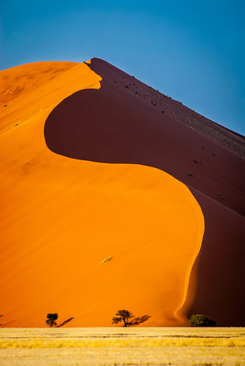 Arid Climate Beauty In Nature Blue Clear Sky Day Desert Environment Heat - Temperature Land Nature No People Orange Color Outdoors Sand Sand Dune Scenics - Nature Sky Travel Travel Destinations