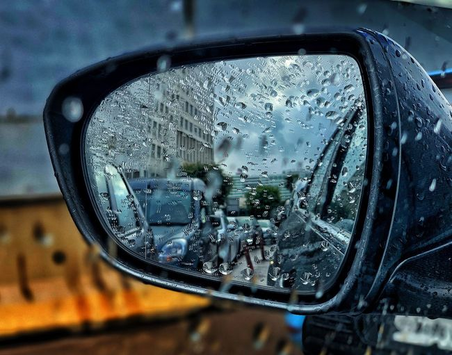 Life in car mirror view Drop Wet Glass - Material Rain Car Motor Vehicle Mode Of Transportation Close-up Transportation Transparent Vehicle Interior Land Vehicle Rainy Season Car Interior Indoors  Vehicle Mirror No People Water Reflection RainDrop