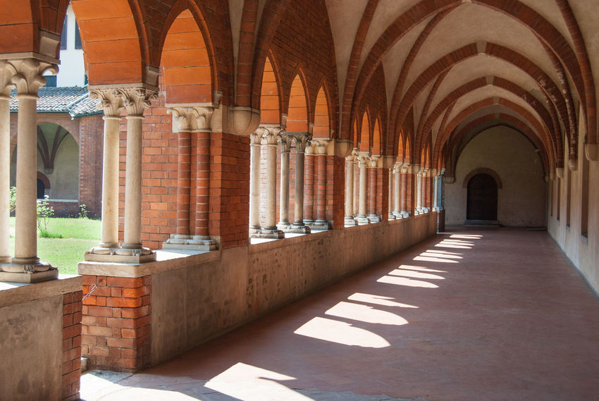 Christianity Abbey Arcade Arch Arched Architectural Column Architecture Building Built Structure Ceiling Chiaravalle, Milano Cistercian Monastery Colonnade Corridor Diminishing Perspective Direction History In A Row No People Place Of Worship Religion Religious Architecture Sunlight The Past The Way Forward