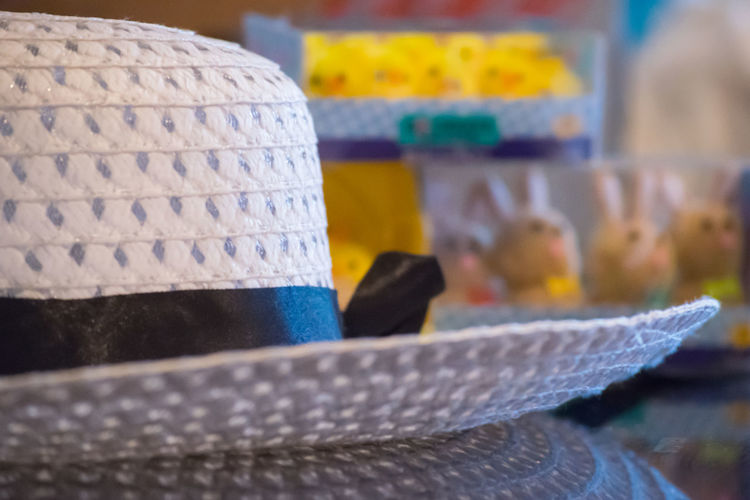 Easter Ready Hat Bonnet Easter Bonnet Bunnies Chicks Bokeh Focus On Foreground Tradition Craft Creativity Childhood Easter Headwear Reflection Close-up Glass Surfaces Glass Reflection Straw Hat White Holes Day Horizontal Colour Image Blurred Background