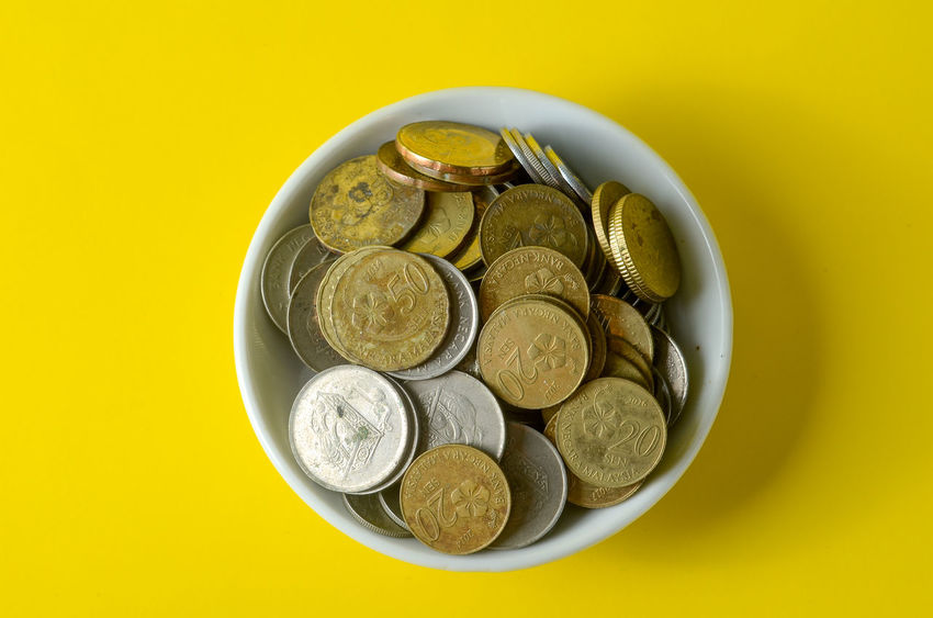 Bowl Coin Colored Background Currency Cut Out Directly Above Finance Food Food And Drink Freshness Healthy Eating High Angle View Indoors  Large Group Of Objects No People Still Life Studio Shot Table Yellow Yellow Background
