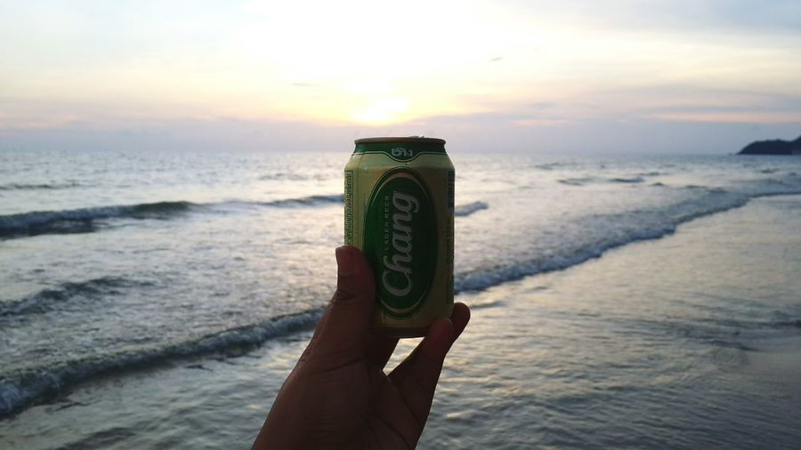 Beach Sea Sunset Vacations Outdoors Sand Nature One Person Sky Shadow And Light Beerchang Thailand Day Lager Beer Beer Time