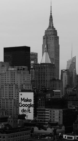 And then your brain will be as useless as eating soup with a fork. Architecture Midtown Manhattan Photography Landscape Outdoors From Up High Black And White Advertisement City Cityscape Urban Skyline Modern Skyscraper City Life Sky Billboard Commercial Sign Tall - High