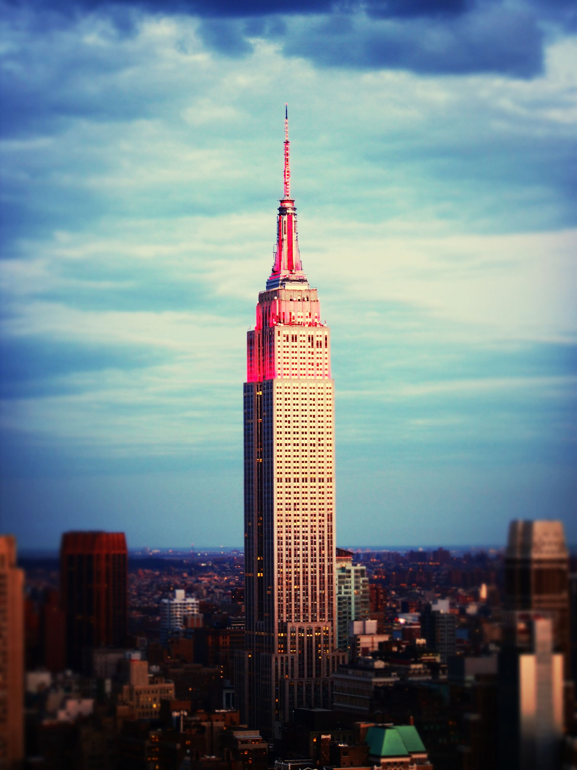 architecture, building exterior, built structure, city, tower, sky, cityscape, tall - high, skyscraper, cloud - sky, capital cities, modern, cloudy, cloud, travel destinations, office building, famous place, city life, tall, empire state building