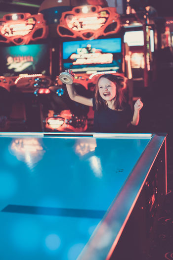 The face of victory! Arcade Games Children Games Air Hockey Arcade Childhood Hobbies Illuminated Indoors  Leisure Activity Lifestyles One Person Portrait Real People
