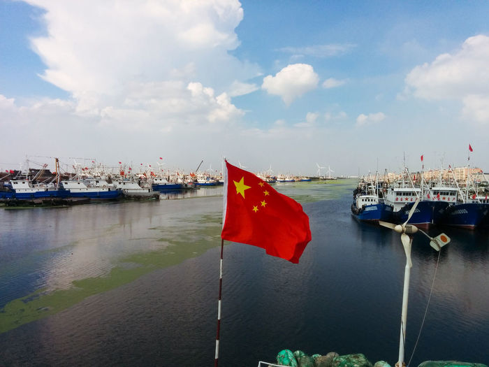 Blue Blue Sky Boats China Chinese Flag Coast Fishing Boat Focus On Foreground Moored Nautical Vessel Outdoors River Shanghai Travel Traveling In China Vacation Water