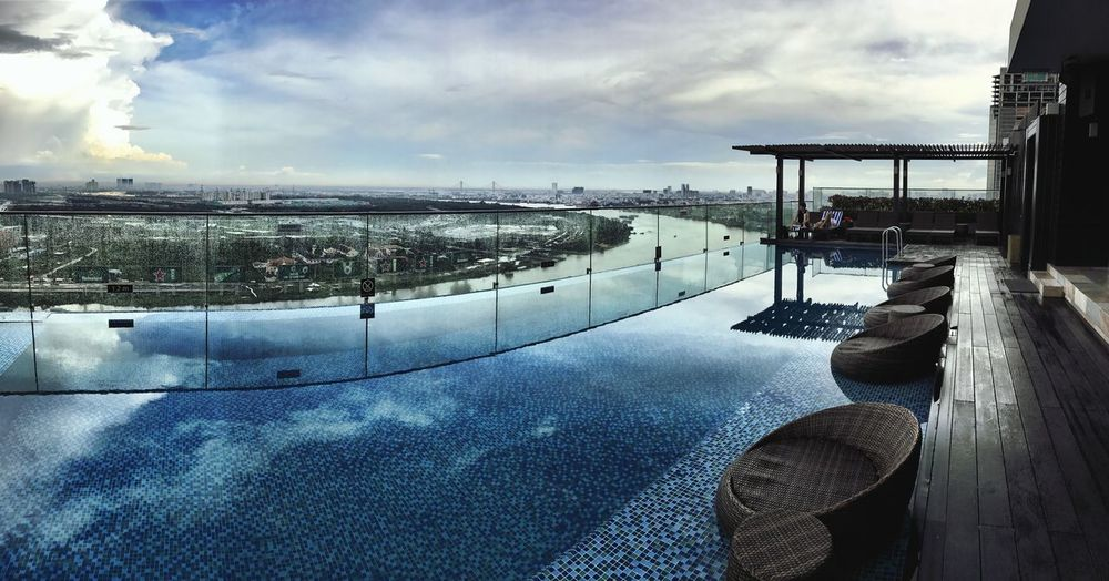 A pool with a view Sky Cloud - Sky Architecture Outdoors Water Day No People Mekong River Riverside City Modern Vietnam Ho Chi Minh City Streetphotography Panoramic Enjoying The View Roof Top Pool Swimming Pool Blue Iphone7 IPhoneography Travel Destinations Travel Photography Shotoniphone7